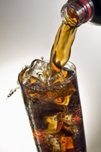 17028623-pouring-a-glass-of-coca-cola-with-ice-cubes
