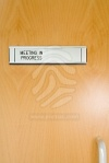 royalty-free-photos-a-closed-office-door-with-meeting-in-progress-sign-pixmac-66197375
