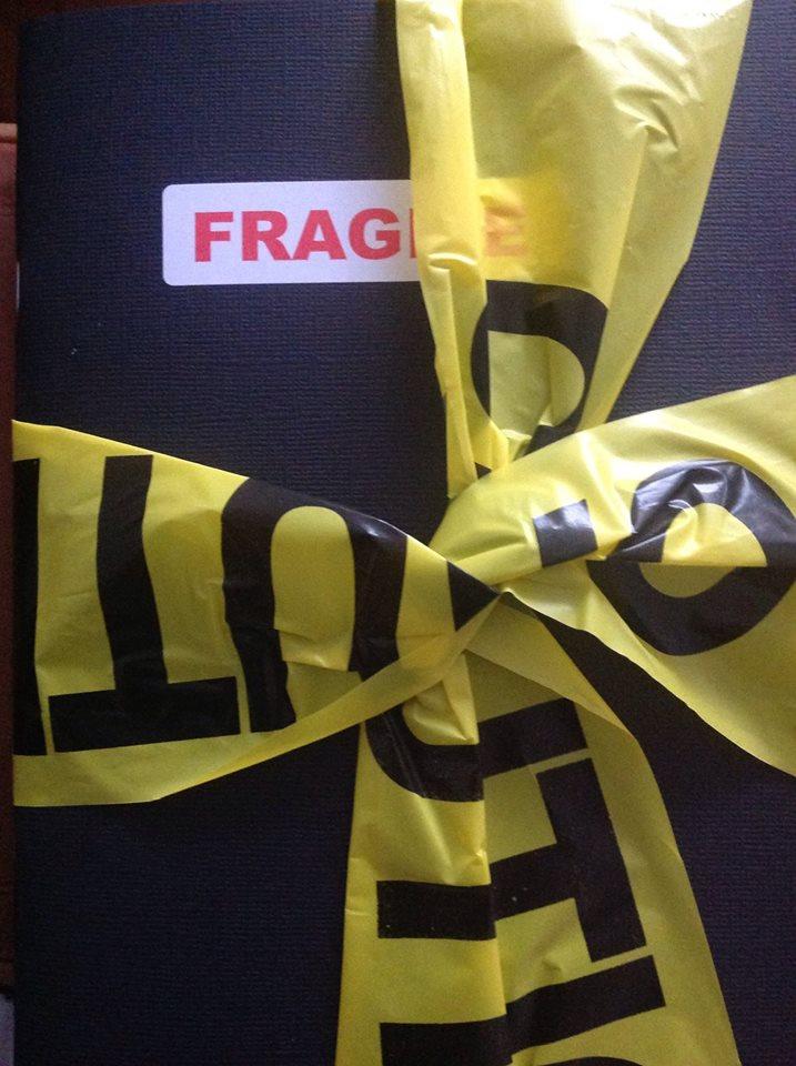 caution poet book Fragile