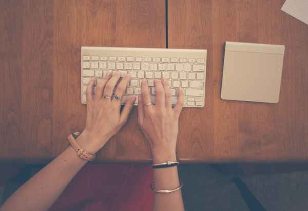 hands-woman-apple-desk.jpg