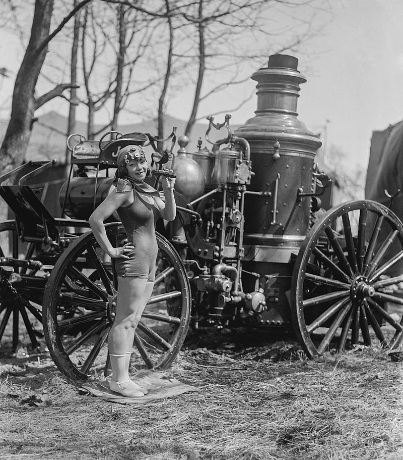 Bea_Kyle_Standing_Fire_Engine_and_Pickle_1924,_edited